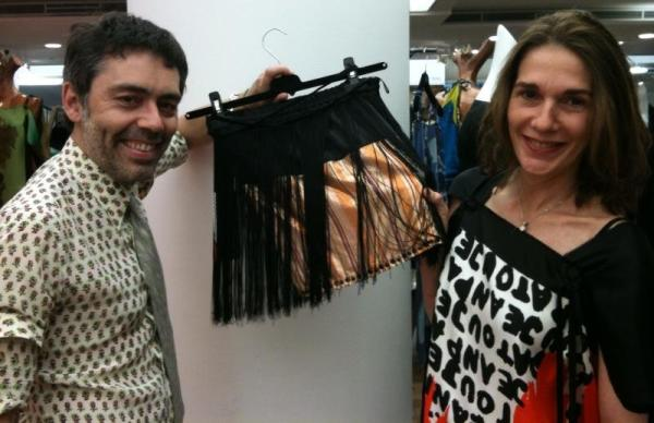 Designers of E2, Michèle and Olivier Chatenet with fringed metallic mini skirt