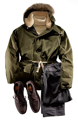 Nigel Cabourn Waterproof cotton-and-hand-stuffed-down parka with coyote-fur trim ($2,985), wool turtleneck ($315), and cotton-and-wool trousers with braces ($665) by Nigel Cabourn; leather boots ($435) by Alden.